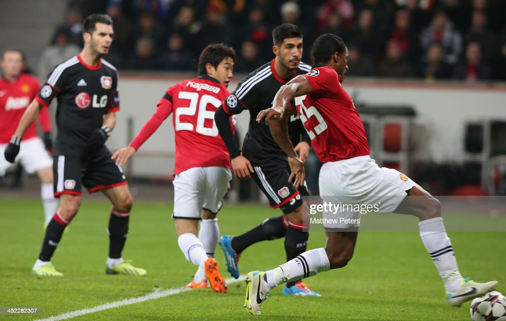 <a gi-track='captionPersonalityLinkClicked' href=/galleries/search?phrase=Antonio+Valencia&family=editorial&specificpeople=543830 ng-click='$event.stopPropagation()'>Antonio Valencia</a> of Manchester United scores their first goal during the UEFA Champions League Group A match between Bayer Leverkusen and Manchester United at BayArena on November 27, 2013 in Leverkusen, North Rhine-Westphalia.