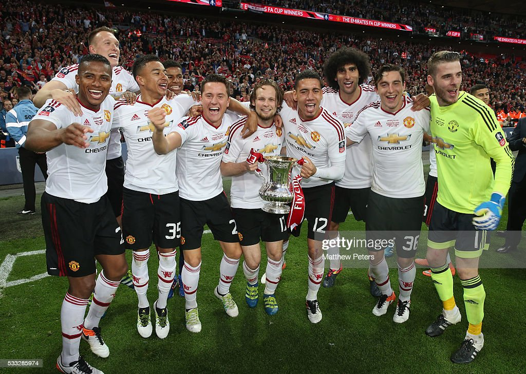 <a gi-track='captionPersonalityLinkClicked' href=/galleries/search?phrase=Antonio+Valencia&family=editorial&specificpeople=543830 ng-click='$event.stopPropagation()'>Antonio Valencia</a>, <a gi-track='captionPersonalityLinkClicked' href=/galleries/search?phrase=Phil+Jones+-+Soccer+Player&family=editorial&specificpeople=7841291 ng-click='$event.stopPropagation()'>Phil Jones</a>, <a gi-track='captionPersonalityLinkClicked' href=/galleries/search?phrase=Jesse+Lingard&family=editorial&specificpeople=7601596 ng-click='$event.stopPropagation()'>Jesse Lingard</a>, <a gi-track='captionPersonalityLinkClicked' href=/galleries/search?phrase=Ander+Herrera&family=editorial&specificpeople=6331880 ng-click='$event.stopPropagation()'>Ander Herrera</a>, <a gi-track='captionPersonalityLinkClicked' href=/galleries/search?phrase=Daley+Blind&family=editorial&specificpeople=5566498 ng-click='$event.stopPropagation()'>Daley Blind</a>, <a gi-track='captionPersonalityLinkClicked' href=/galleries/search?phrase=Chris+Smalling&family=editorial&specificpeople=5964313 ng-click='$event.stopPropagation()'>Chris Smalling</a>, <a gi-track='captionPersonalityLinkClicked' href=/galleries/search?phrase=Marouane+Fellaini&family=editorial&specificpeople=3936316 ng-click='$event.stopPropagation()'>Marouane Fellaini</a>, <a gi-track='captionPersonalityLinkClicked' href=/galleries/search?phrase=Matteo+Darmian&family=editorial&specificpeople=7096006 ng-click='$event.stopPropagation()'>Matteo Darmian</a> and <a gi-track='captionPersonalityLinkClicked' href=/galleries/search?phrase=David+de+Gea&family=editorial&specificpeople=3000749 ng-click='$event.stopPropagation()'>David de Gea</a> of Manchester United celebrate after The Emirates FA Cup final match between Manchester United and Crystal Palace at Wembley Stadium on May 21, 2016 in London, England.