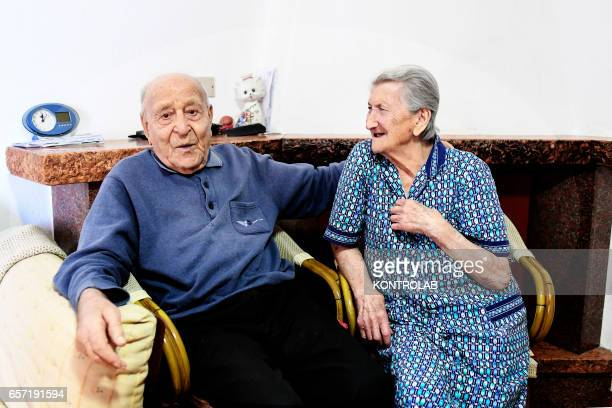 Antonio Vassallo 100 yearsold and his wife Amina Fedollo pose in their house in Acciaroli southern Italy Situated on the western coast of southern...