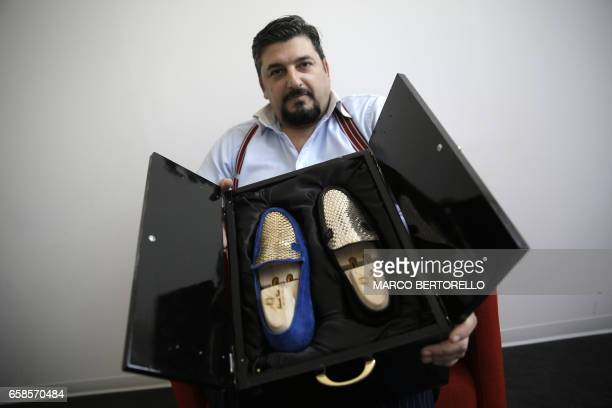 Antonio Vietri artisan and founder of AV Fashion shows men shoes as part of his collection 'Gold' on March 16 2017 in his workshop in Turin Antonio...