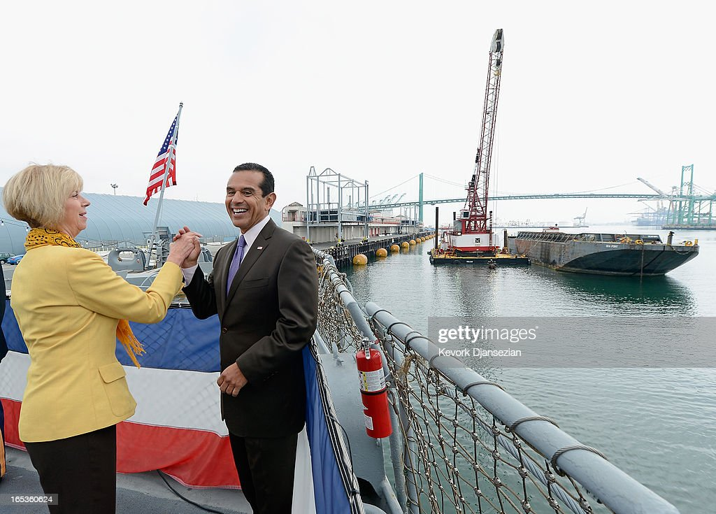 <a gi-track='captionPersonalityLinkClicked' href=/galleries/search?phrase=Antonio+Villaraigosa&family=editorial&specificpeople=178925 ng-click='$event.stopPropagation()'>Antonio Villaraigosa</a>, Mayor of Los Angeles celebrates with U.S. Rep. Janice Hahn (D-CA) after large crane lifted up the last ceremonial last scoop of dirt from the main navigational channel of Port of Los Angeles to complete Port's Main Channel Deepening Project on April 3, 2013 in San Pedro area of Los Angeles, California. The project which took 10 years and $370 million to complete, deepened the channel 53 feet to accommodate bigger and more modern vessel from around the world.