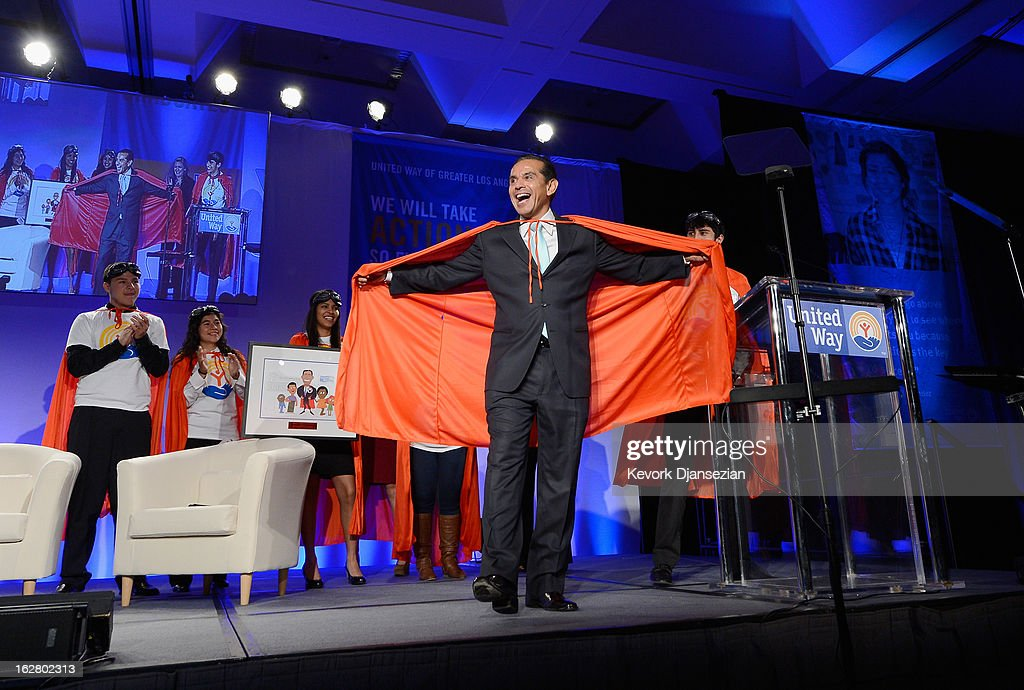 Antonio Villaraigosa Mayor of Los Angeles shows off his superhero cape after it was presented to him by students championing education reform during...
