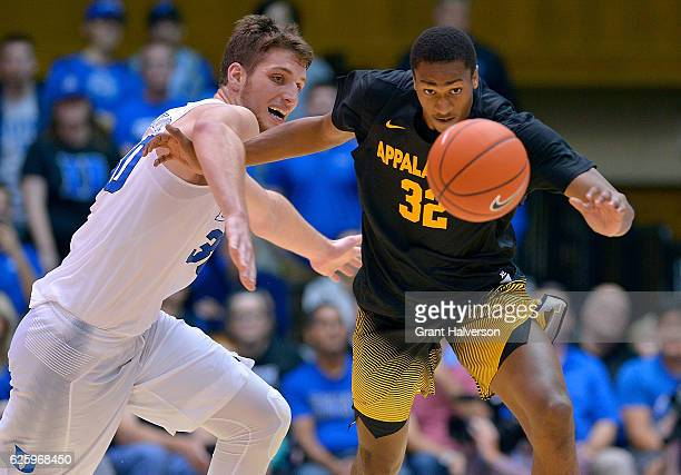 Antonio Vrankovic of the Duke Blue Devils and Tyrell Johnson of the Appalachian State Mountaineers chase down a loose ball during the game at Cameron...