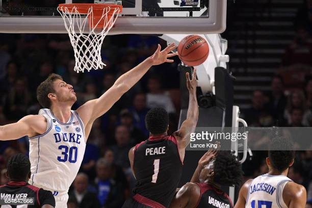 Antonio Vrankovic of the Duke Blue Devils defends a shot by Daniel Peace of the Troy Trojans during the first round of the 2017 NCAA Men's Basketball...