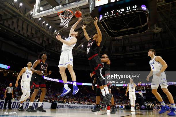 Antonio Vrankovic of the Duke Blue Devils shoots against Alex Hicks of the Troy Trojans in the second half during the first round of the 2017 NCAA...