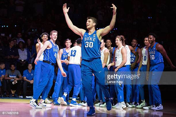 Antonio Vrankovic of the Duke Blue Devils waves to fans during player introductions during Countdown To Craziness at Cameron Indoor Stadium on...