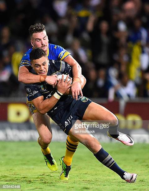 Antonio Winterstein of the Cowboys is tackled by Clint Gutherson of the Eels during the round eight NRL match between the North Queensland Cowboys...