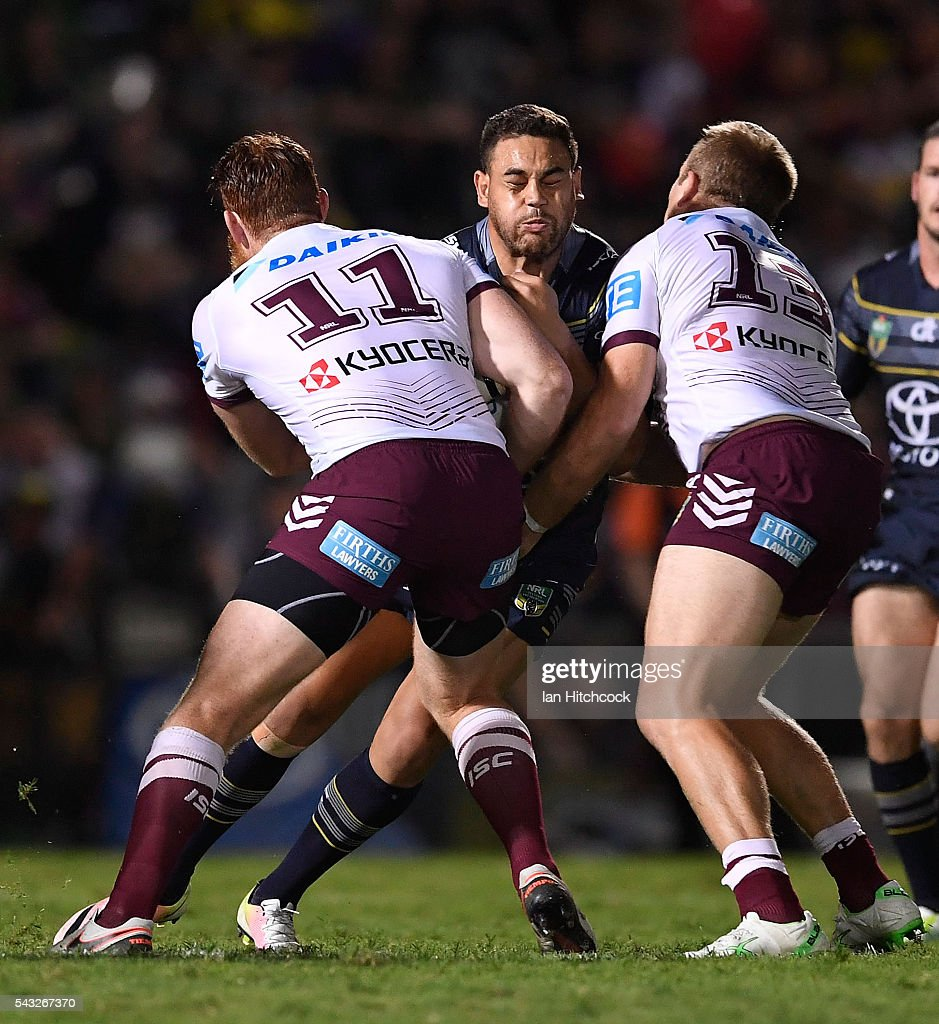 Antonio Winterstein of the Cowboys is tackled by Nathan Green and Jake Trbojevic of the Sea Eagles during the round 16 NRL match between the North Queensland Cowboys and the Manly Sea Eagles at 1300SMILES Stadium on June 27, 2016 in Townsville, Australia.
