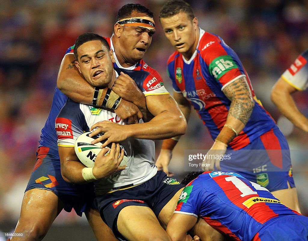 Antonio Winterstein of the Cowboys tries to break through the Knights defence during the round three NRL match between the Newcastle Knights and the North Queensland Cowboys at Hunter Stadium on March 25, 2013 in Newcastle, Australia.
