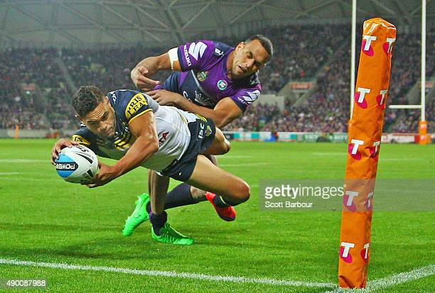 Antonio Winterstein the Cowboys dives to score a try which was later disallowed during the NRL Second Preliminary Final match between the Melbourne...