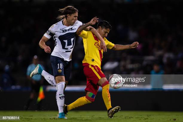 AntonioGarcia of Pumas fights for the ball with Raul Ruidiaz of Morelia during the 6th round match between Pumas UNAM and Morelia as part of the...