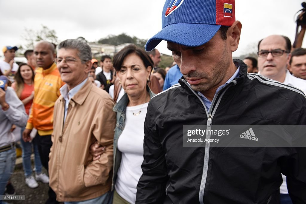 Antonioneta Mendoza (C) mother of jailed opposition leader Leopoldo Lopez and Governor of Miranda state Henrique Capriles (R) are seen outside the military prison of Ramo Verde, where her son is jailed on his 45th Birthday in Los Teques, Venezuela on April 29, 2016.