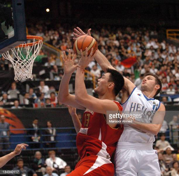 Antonis Fotsis of Greece blocks China's Yao Ming during the Final Eight round of the 2006 FIBA World Championships at the Saitama Super Arena Tokyo...