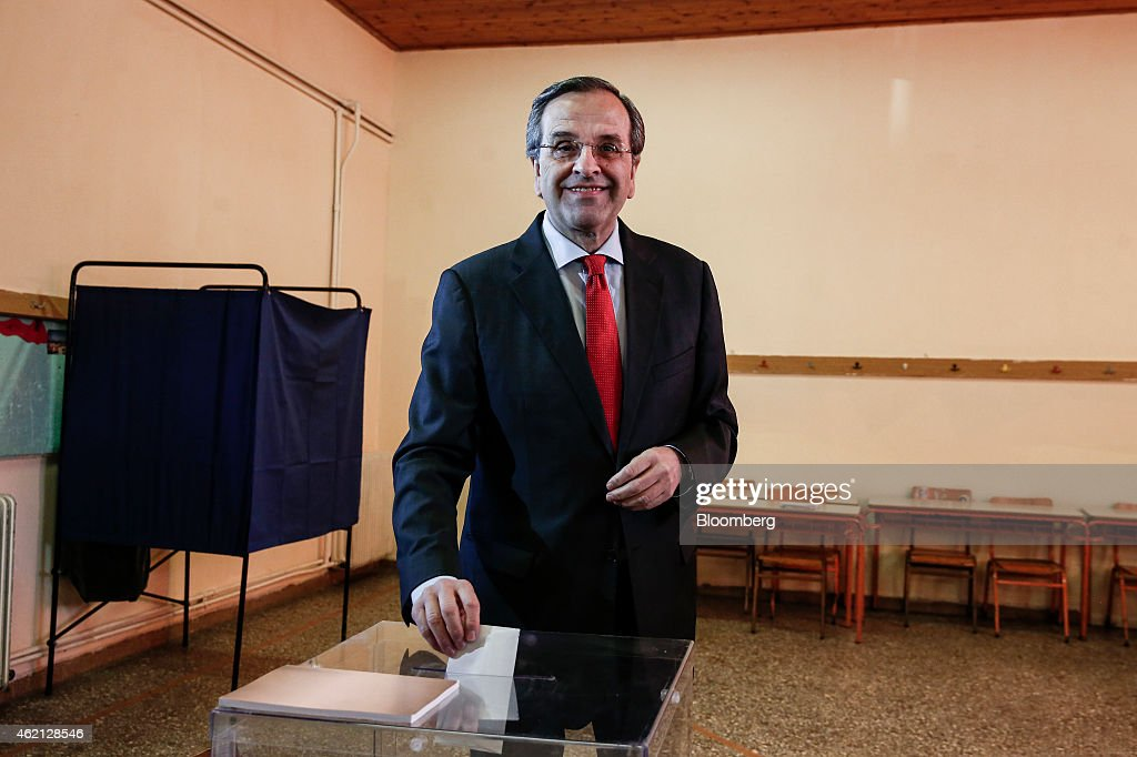 Antonis Samaras, Greece's prime minister, casts his vote at a polling station in the town of Pylos, west of Athens, Greece, on Sunday, Jan. 25, 2015. Greek voters go to the polls today in a general election that will decide whether Europes most-indebted country sticks to the economic-overhaul program set out by its troika of official creditors or tries to chart its own course. Photographer: Yorgos Karahalis/Bloomberg via Getty Images