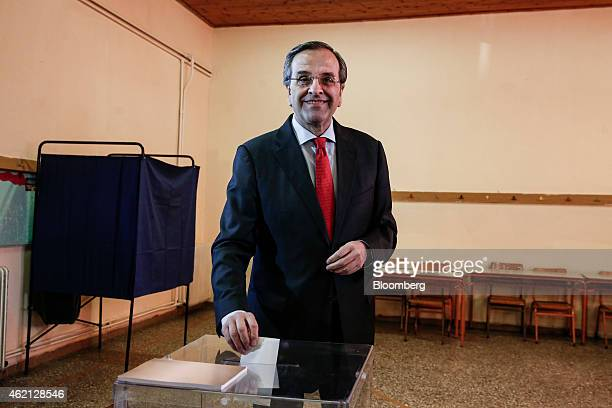 Antonis Samaras Greece's prime minister casts his vote at a polling station in the town of Pylos west of Athens Greece on Sunday Jan 25 2015 Greek...