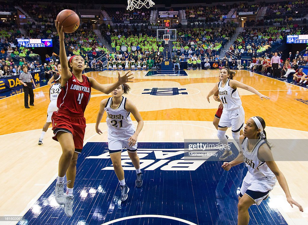 Antonita Slaughter #4 of the Louisville Cardinals shoots the ball against the Notre Dame Fighting Irish at Purcel Pavilion on February 11, 2013 in South Bend, Indiana. Notre Dame defeated Louisville 93-64.