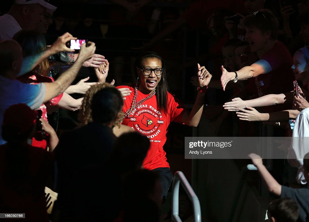 Antonita Slaughter of the Louisville Cardinals womens team walks thru the crowd during the Louisville Cardinals NCAA Basketball Celebration to mark the NCAA championship by the Mens team and the runner-up finish by the womens team at KFC YUM! Center on April 10, 2013 in Louisville, Kentucky.