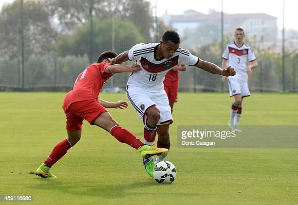 AntonLeander Donkor of Germany challenges Savas Polat of Turkey during the international friendly match between U18 Germany and U18 Turkey on...