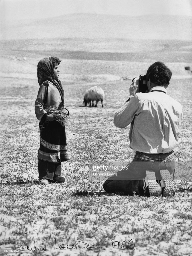 Antony Armstrong-Jones, 1st Earl of Snowdon, photographs a young girl in the countryside in Israel, circa 1986.
