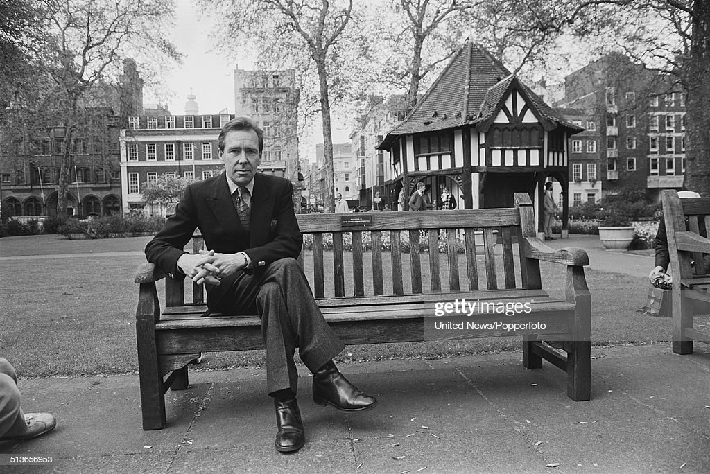 Antony Armstrong-Jones, Lord Snowdon posed sitting on a bench in Soho Square, London on 14th May 1981.