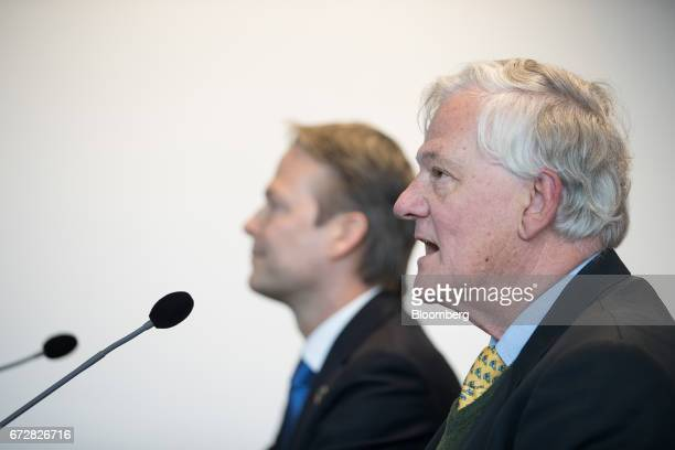Antony Burgmans chairman of Akzo Nobel NV right speaks as Ton Buechner chief executive officer of Akzo Nobel NV looks on during a news conference in...