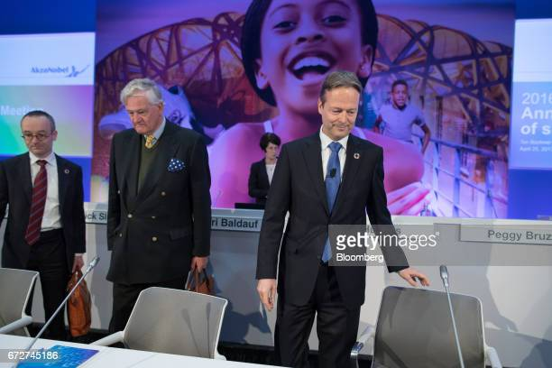 Antony Burgmans chairman of Akzo Nobel NV second left and Ton Buechner chief executive officer of Akzo Nobel NV right arrive for a shareholders'...