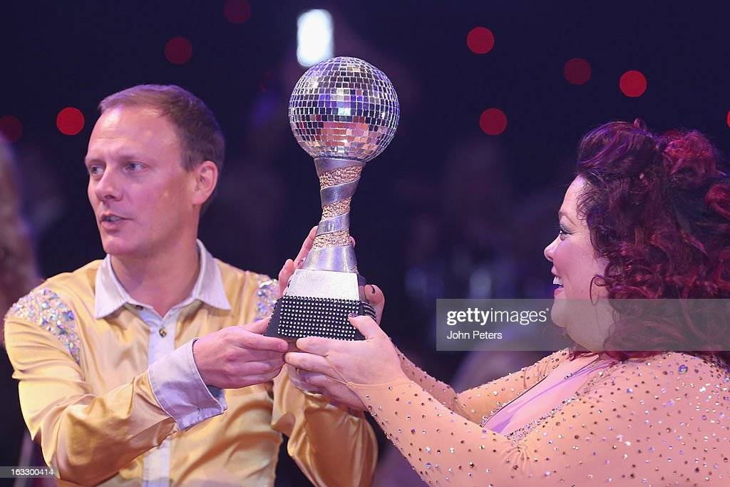 <a gi-track='captionPersonalityLinkClicked' href=/galleries/search?phrase=Antony+Cotton&family=editorial&specificpeople=626694 ng-click='$event.stopPropagation()'>Antony Cotton</a> and Lisa Riley pose with the winners' trophy as part of Dancing with United, in aid of the Manchester United Foundation, at Old Trafford on March 7, 2013 in Manchester, England.