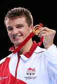 Antony Fowler of England poses during the medal ceremony for the Men's Middle Final at SSE Hydro during day ten of the Glasgow 2014 Commonwealth...