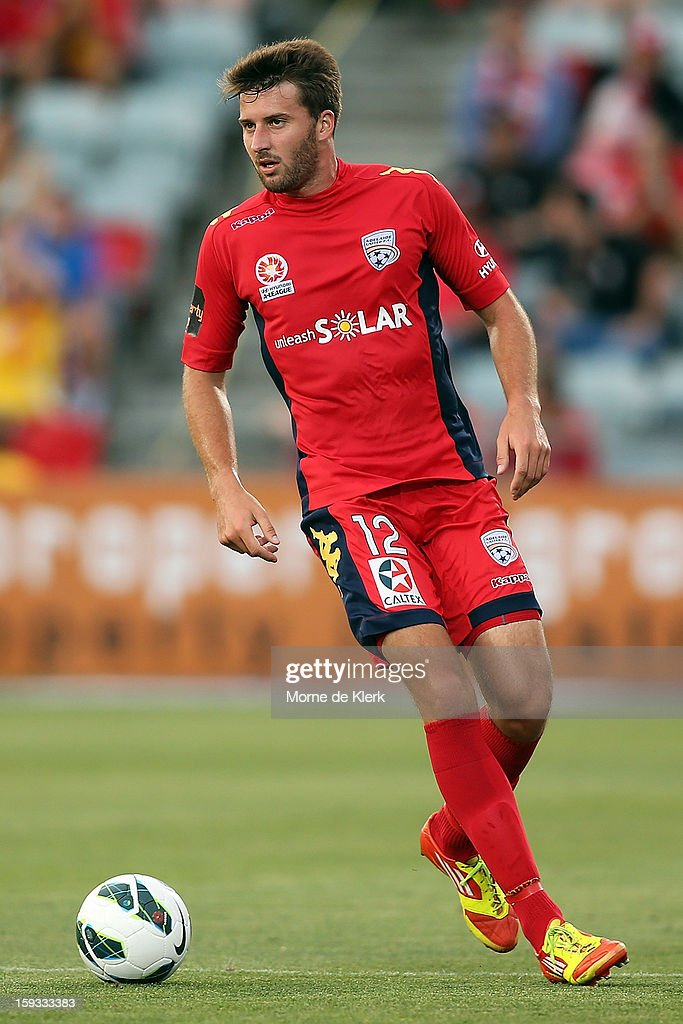 Antony Golec of Adelaide runs with the ball during the round 16 A-League match between Adelaide United and the Perth Glory at Hindmarsh Stadium on January 11, 2013 in Adelaide, Australia.