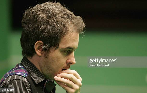 Antony Hamilton of England looks on during his quarter final match against Stephen Maguire of Scotland in the 888com World Championship at the...