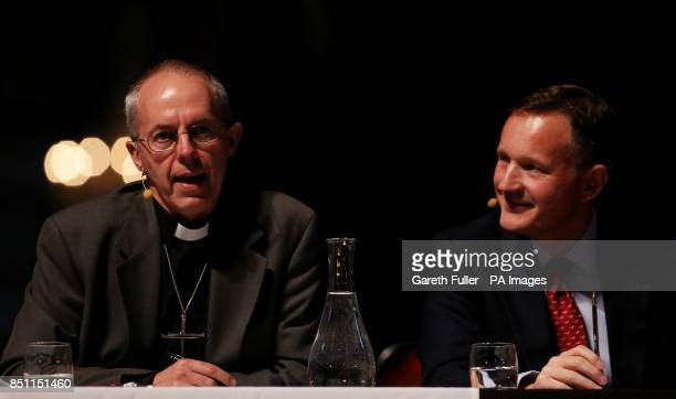Antony Jenkins Group Chief Executive of Barclays listens to Archbishop of Canterbury the Most Reverend Justin Welby answer questions following his...