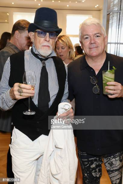 Antony Price and Tim Blanks attend the Dior cocktail party to celebrate the launch of Dior Catwalk by Alexander Fury on July 19 2017 in London England