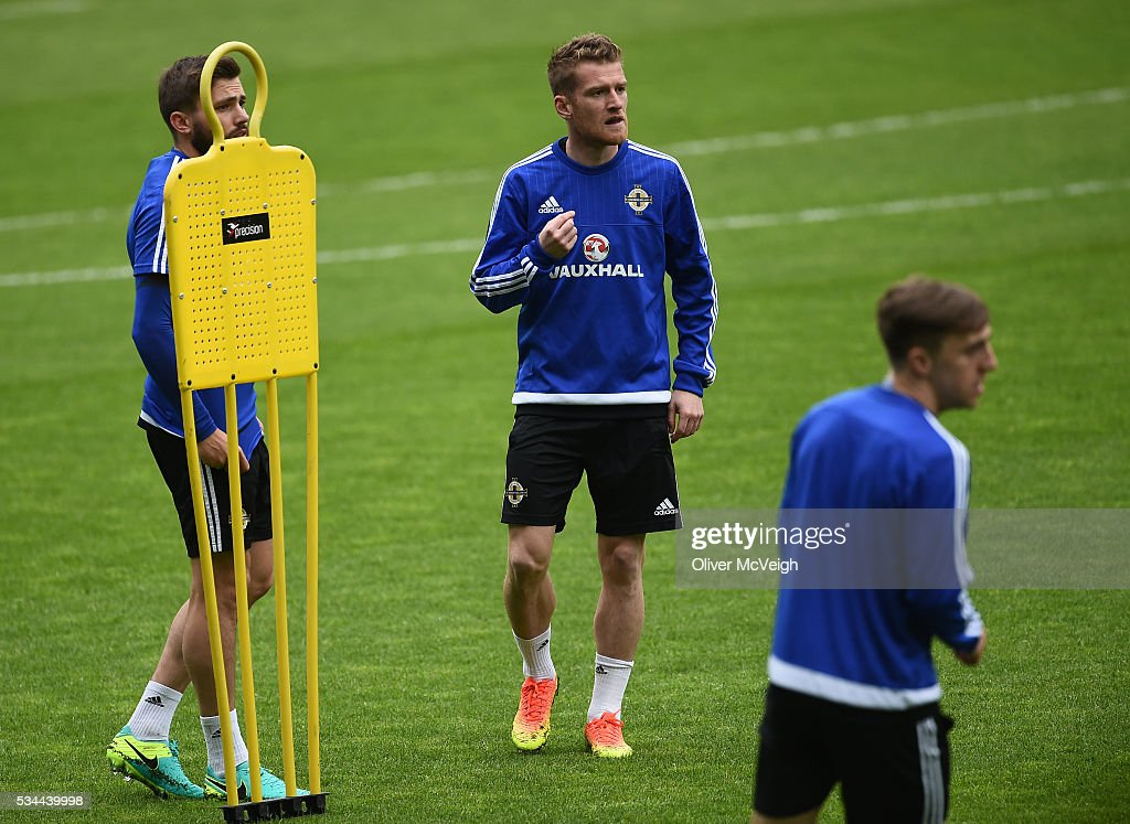 Antrim , Ireland - 26 May 2016; Steve Davis of Northern Ireland, centre, along with Stuart Dallas, left, during squad training at Windsor Park, Belfast, Co. Antrim.