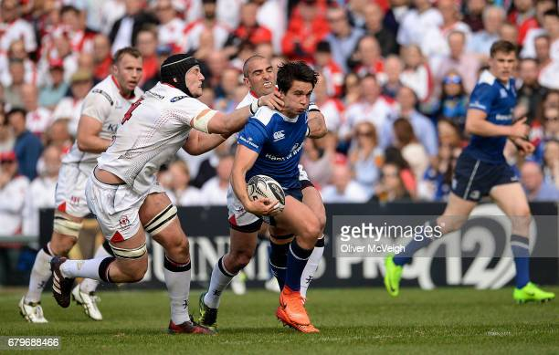 Antrim Ireland 6 May 2017 Joey Carbery of Leinster is tackled by Kieran Treadwell and Ruan Pienaar of Ulster during the Guinness PRO12 Round 22 match...