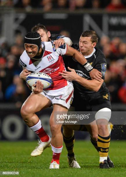 Antrim United Kingdom 13 October 2017 Christian Lealiifano of Ulster is tackled by Elliot Daly and Brendan Macken of Wasps during the European Rugby...