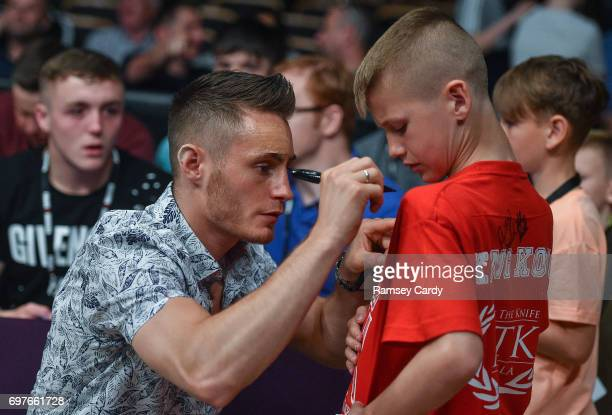 Antrim United Kingdom 17 June 2017 IBF World Bantamweight Championship Ryan Burnett signs autographs at the Battle of Belfast Fight Night at the...