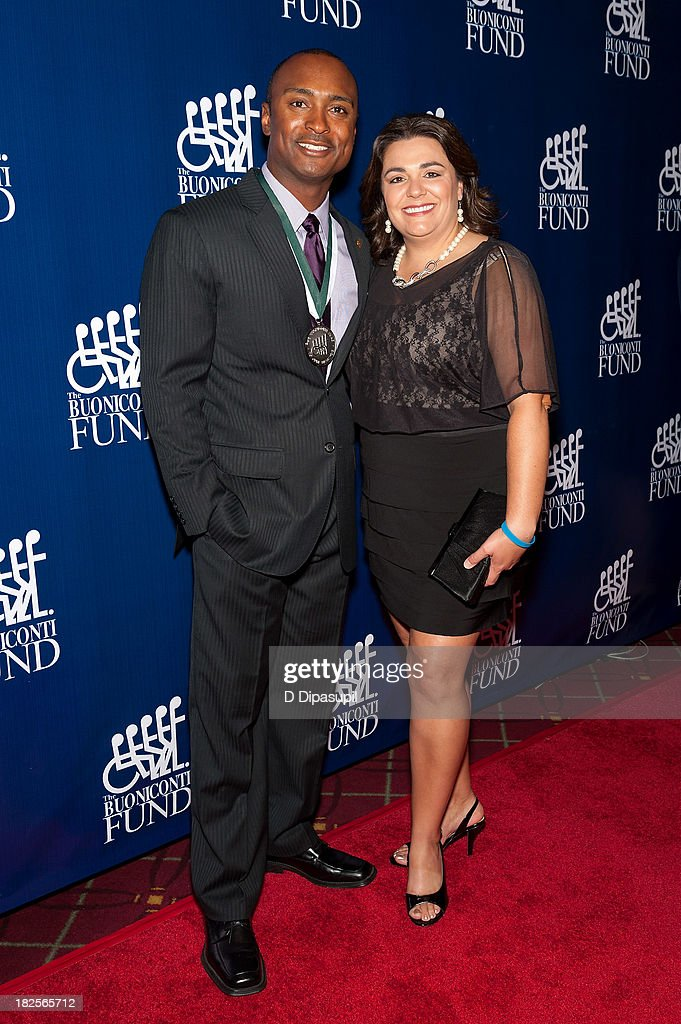 Antron Brown (L) and Billie Jo Brown attend the 28th Annual Great Sports Legends Dinner to Benefit The Buoniconti Fund To Cure Paralysis at The Waldorf=Astoria on September 30, 2013 in New York City.