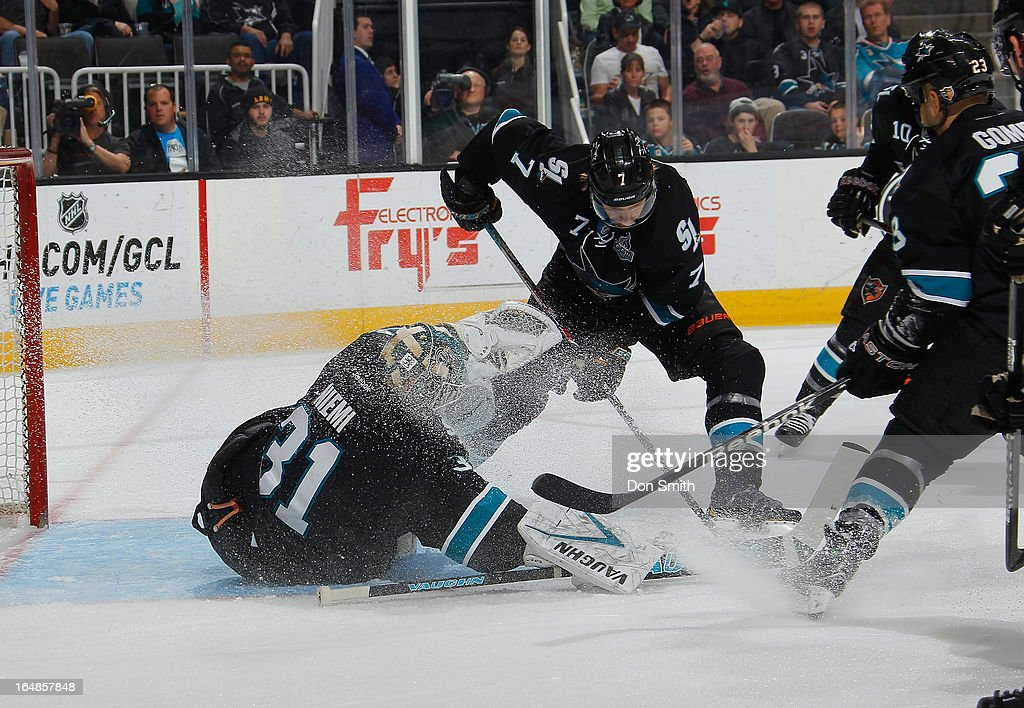 <a gi-track='captionPersonalityLinkClicked' href=/galleries/search?phrase=Antti+Niemi&family=editorial&specificpeople=213913 ng-click='$event.stopPropagation()'>Antti Niemi</a> #31 and <a gi-track='captionPersonalityLinkClicked' href=/galleries/search?phrase=Brad+Stuart+-+Ice+Hockey+Player&family=editorial&specificpeople=213995 ng-click='$event.stopPropagation()'>Brad Stuart</a> #7 of the San Jose Sharks freeze the puck against the Detroit Red Wings during an NHL game on March 28, 2013 at HP Pavilion in San Jose, California.