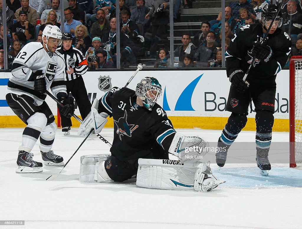 <a gi-track='captionPersonalityLinkClicked' href=/galleries/search?phrase=Antti+Niemi&family=editorial&specificpeople=213913 ng-click='$event.stopPropagation()'>Antti Niemi</a> #31 and <a gi-track='captionPersonalityLinkClicked' href=/galleries/search?phrase=Brad+Stuart+-+Ice+Hockey+Player&family=editorial&specificpeople=213995 ng-click='$event.stopPropagation()'>Brad Stuart</a> #7 of the San Jose Sharks protect the net against <a gi-track='captionPersonalityLinkClicked' href=/galleries/search?phrase=Marian+Gaborik&family=editorial&specificpeople=202477 ng-click='$event.stopPropagation()'>Marian Gaborik</a> #12 of the Los Angeles Kings in Game One of the First Round of the 2014 Stanley Cup Playoffs at SAP Center on April 17, 2014 in San Jose, California.