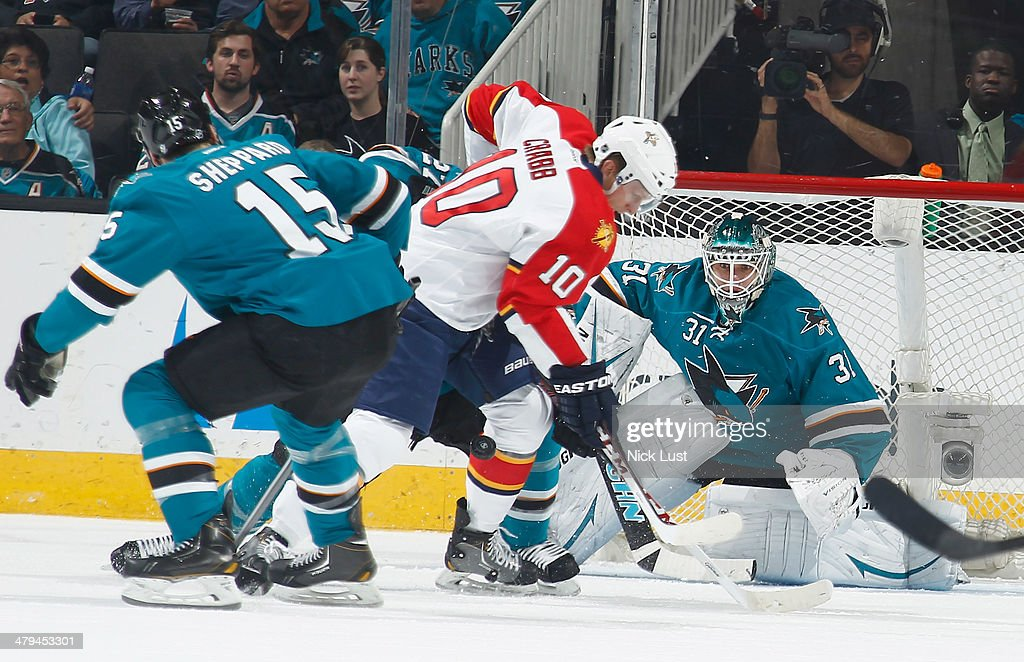 Antti Niemi and James Sheppard of the San Jose Sharks protect the net against Joey Crabb of the Florida Panthers during an NHL game on March 18 2014...