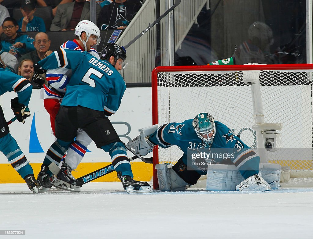 Antti Niemi #31 and Jason Demers #10 of the San Jose Sharks protect the net against the New York Rangers during an NHL game on October 8, 2013 at SAP Center in San Jose, California.