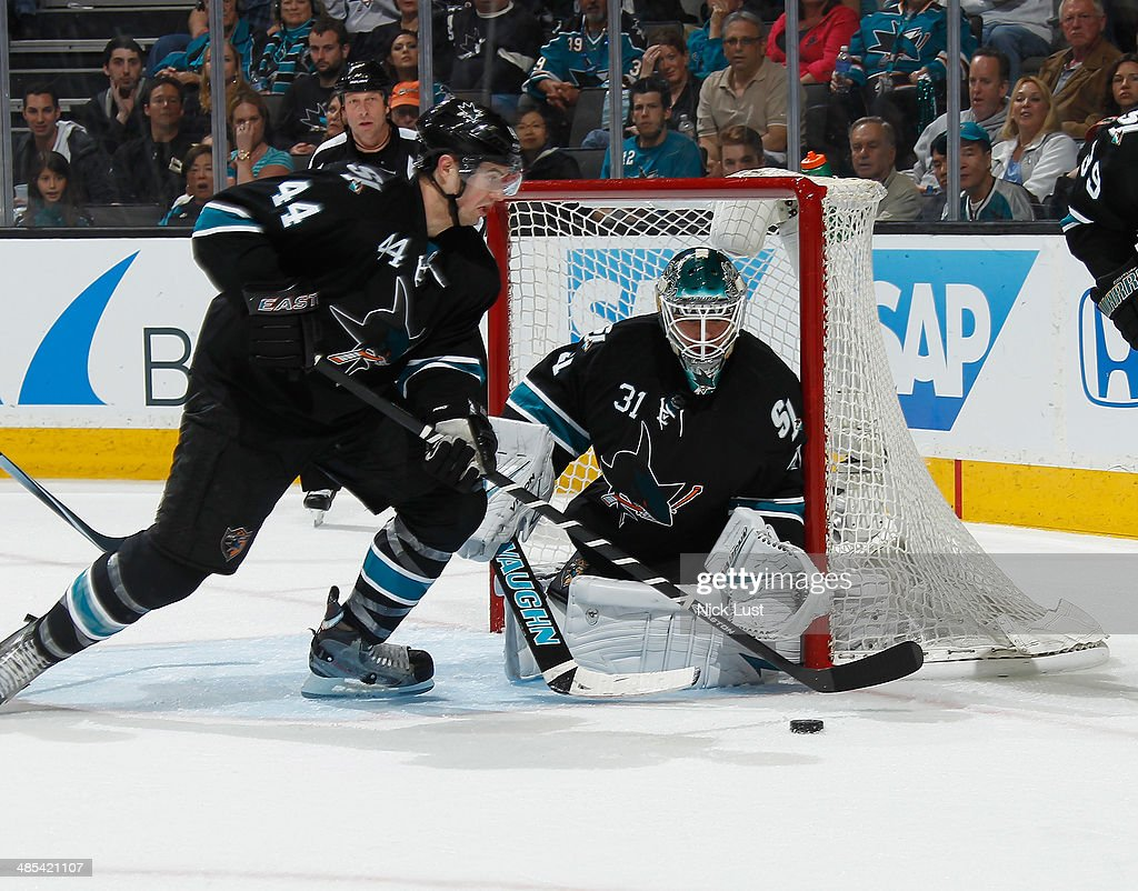 <a gi-track='captionPersonalityLinkClicked' href=/galleries/search?phrase=Antti+Niemi&family=editorial&specificpeople=213913 ng-click='$event.stopPropagation()'>Antti Niemi</a> #31 and <a gi-track='captionPersonalityLinkClicked' href=/galleries/search?phrase=Marc-Edouard+Vlasic&family=editorial&specificpeople=880807 ng-click='$event.stopPropagation()'>Marc-Edouard Vlasic</a> #44 of the San Jose Sharks protect the net against the Los Angeles Kings in Game One of the First Round of the 2014 Stanley Cup Playoffs at SAP Center on April 17, 2014 in San Jose, California.