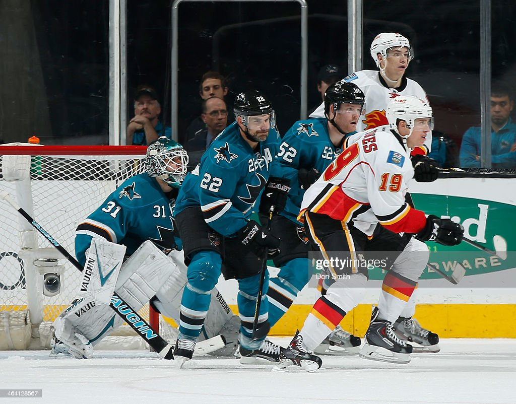 <a gi-track='captionPersonalityLinkClicked' href=/galleries/search?phrase=Antti+Niemi&family=editorial&specificpeople=213913 ng-click='$event.stopPropagation()'>Antti Niemi</a> #31, <a gi-track='captionPersonalityLinkClicked' href=/galleries/search?phrase=Dan+Boyle&family=editorial&specificpeople=201502 ng-click='$event.stopPropagation()'>Dan Boyle</a> #22 and Matt Irwin #52 of the San Jose Sharks create traffic in front of the net against Blair Jones #19 of the Calgary Flames during an NHL game on January 20, 2014 at SAP Center in San Jose, California.