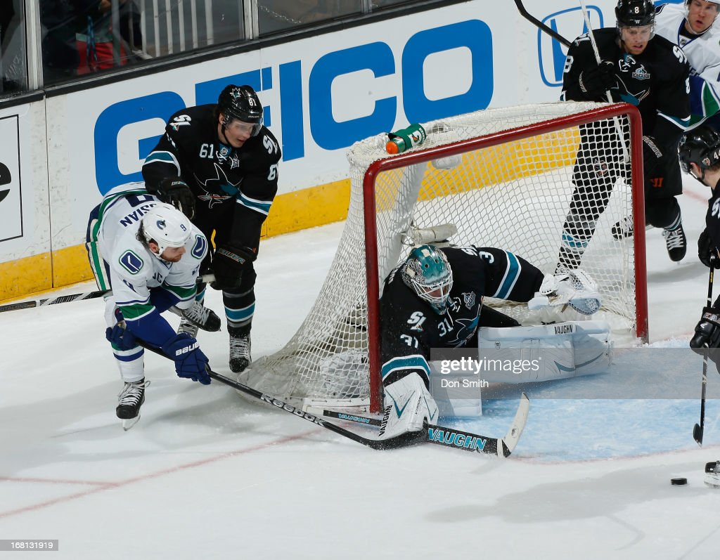Antti Niemi #31, Justin Braun #61 and Joe Pavelski #8 of the San Jose Sharks defend the net against Zack Kassian #9 of the Vancouver Canucks in Game One of the Western Conference Quarterfinals during the 2013 Stanley Cup Playoffs at HP Pavilion on May 5, 2013 in San Jose, California.