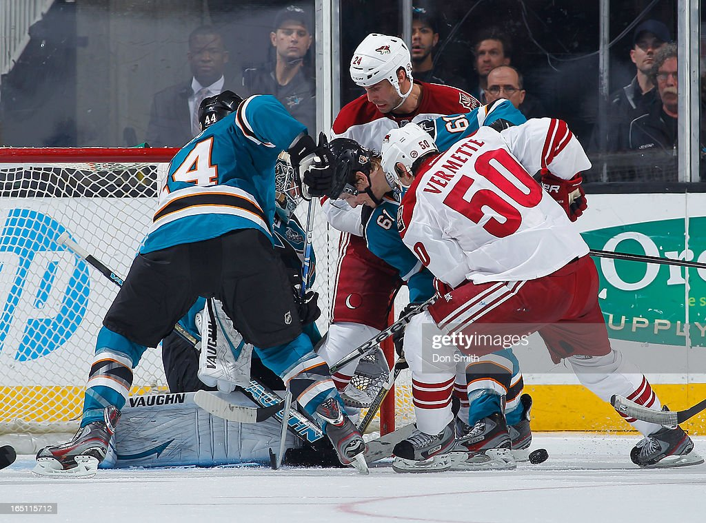 <a gi-track='captionPersonalityLinkClicked' href=/galleries/search?phrase=Antti+Niemi&family=editorial&specificpeople=213913 ng-click='$event.stopPropagation()'>Antti Niemi</a> #31, Justin Braun #61 and <a gi-track='captionPersonalityLinkClicked' href=/galleries/search?phrase=Marc-Edouard+Vlasic&family=editorial&specificpeople=880807 ng-click='$event.stopPropagation()'>Marc-Edouard Vlasic</a> #44 of the San Jose Sharks defend the net against <a gi-track='captionPersonalityLinkClicked' href=/galleries/search?phrase=Antoine+Vermette&family=editorial&specificpeople=206302 ng-click='$event.stopPropagation()'>Antoine Vermette</a> #50 and <a gi-track='captionPersonalityLinkClicked' href=/galleries/search?phrase=Kyle+Chipchura&family=editorial&specificpeople=879784 ng-click='$event.stopPropagation()'>Kyle Chipchura</a> #24 of the Phoenix Coyotes during an NHL game on March 30, 2013 at HP Pavilion in San Jose, California.