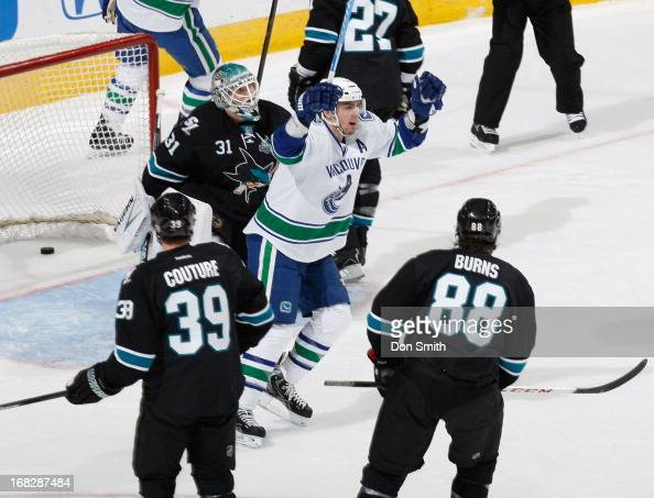 Antti Niemi Logan Couture and Brent Burns of the San Jose Sharks watch as Alexandre Burrows of the Vancouver Canucks in Game Four of the Western...