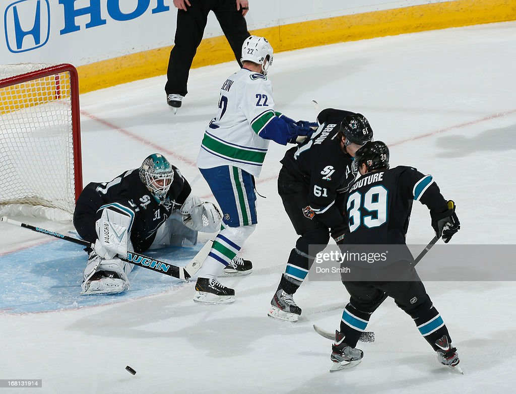 Antti Niemi #31, Logan Couture #39 and Justin Braun #61 of the San Jose Sharks defend the net against Daniel Sedin #22 of the Vancouver Canucks in Game One of the Western Conference Quarterfinals during the 2013 Stanley Cup Playoffs at HP Pavilion on May 5, 2013 in San Jose, California.