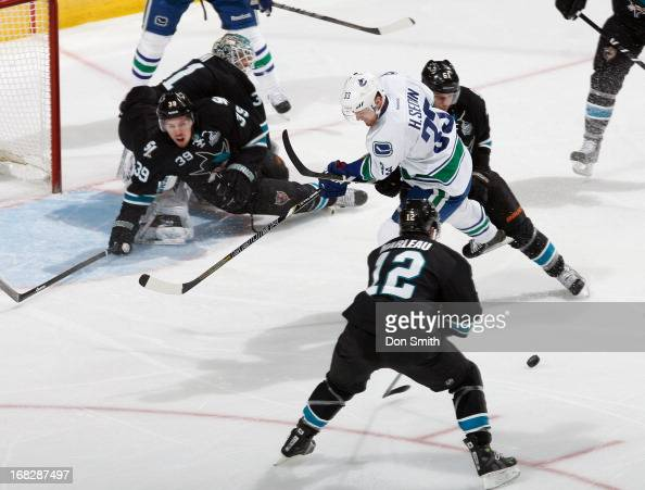 Antti Niemi Logan Couture Justin Braun and Patrick Marleau of the San Jose Sharks defend the net against Henrik Sedin of the Vancouver Canucks in...