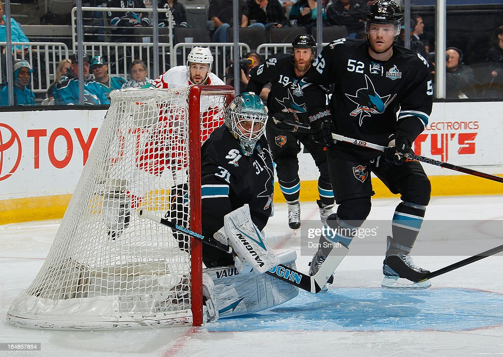 <a gi-track='captionPersonalityLinkClicked' href=/galleries/search?phrase=Antti+Niemi&family=editorial&specificpeople=213913 ng-click='$event.stopPropagation()'>Antti Niemi</a> #31and Matt Irwin #52 of the San Jose Sharks defend the net against the Detroit Red Wings during an NHL game on March 28, 2013 at HP Pavilion in San Jose, California.
