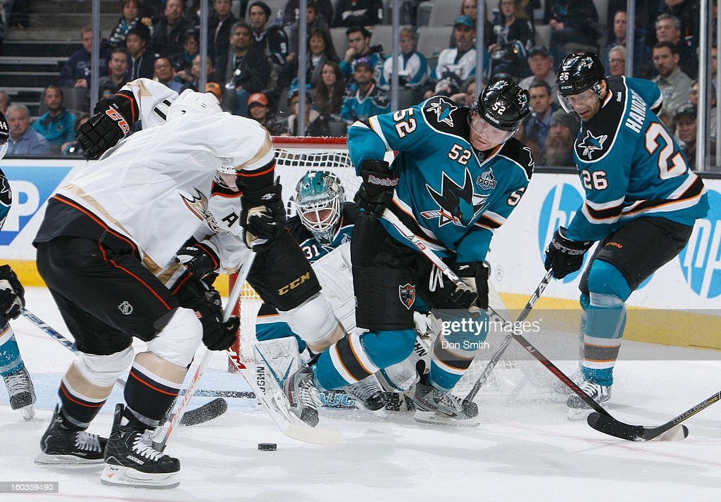Antti Niemi #31, Matthew Irwin #52 and Michal Handzus #26 of the San Jose Sharks defend the net against the Anaheim Ducks during an NHL game on January 29, 2013 at HP Pavilion in San Jose, California.